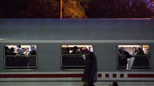 Inmigrantes en una estación de tren