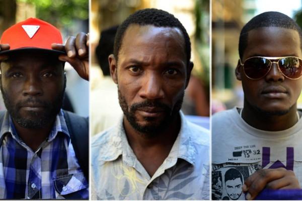 Imagen de tres inmigrantes haitianos