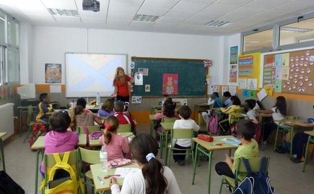 una clase y la profesora