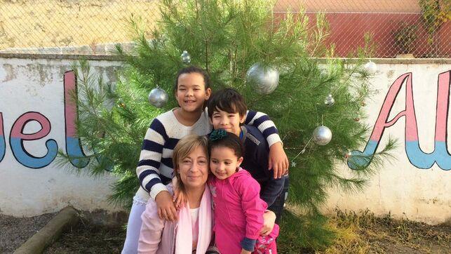 La profesora Mariví con su alumnado