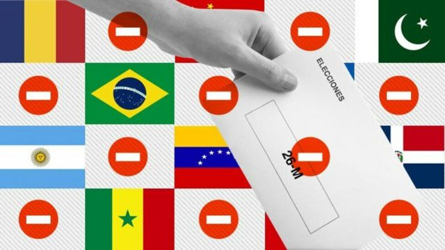 imagen de una mano que vota sobre un fondo de banderas y con señales de prohibido