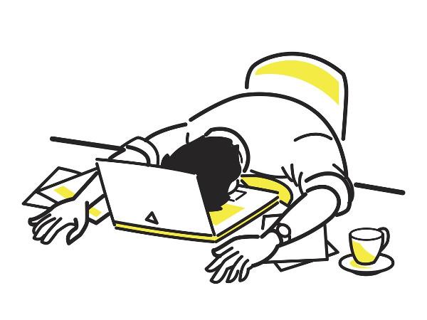 un hombre hunde la cara en un ordenador portátil